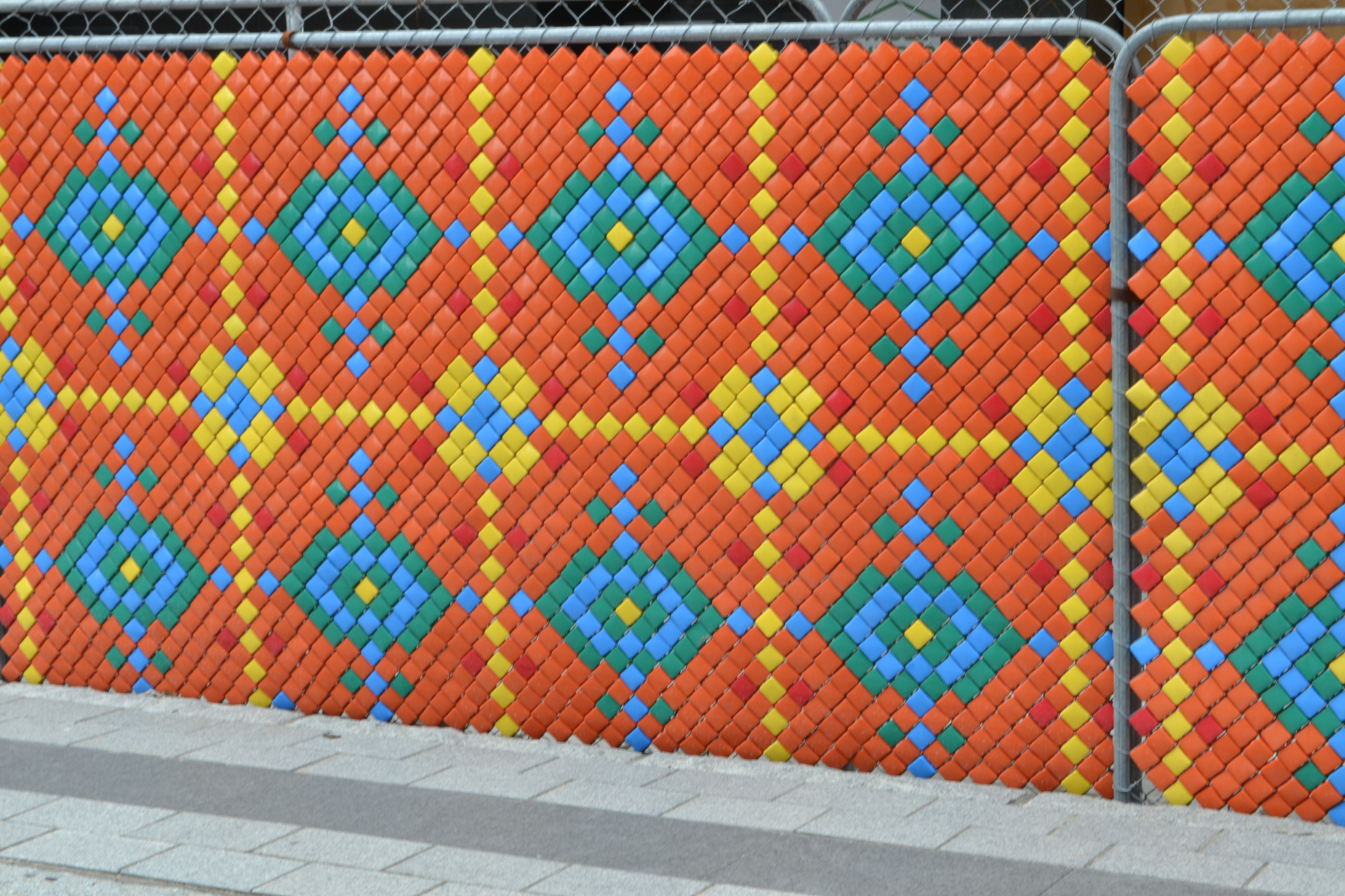 Chainlink fences are turned into art projects
